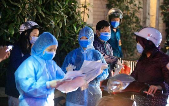 Ca Covid-19 thứ 23 tại Hà Nội từng đến phòng công chứng ở Duy Tân - Ảnh 1.