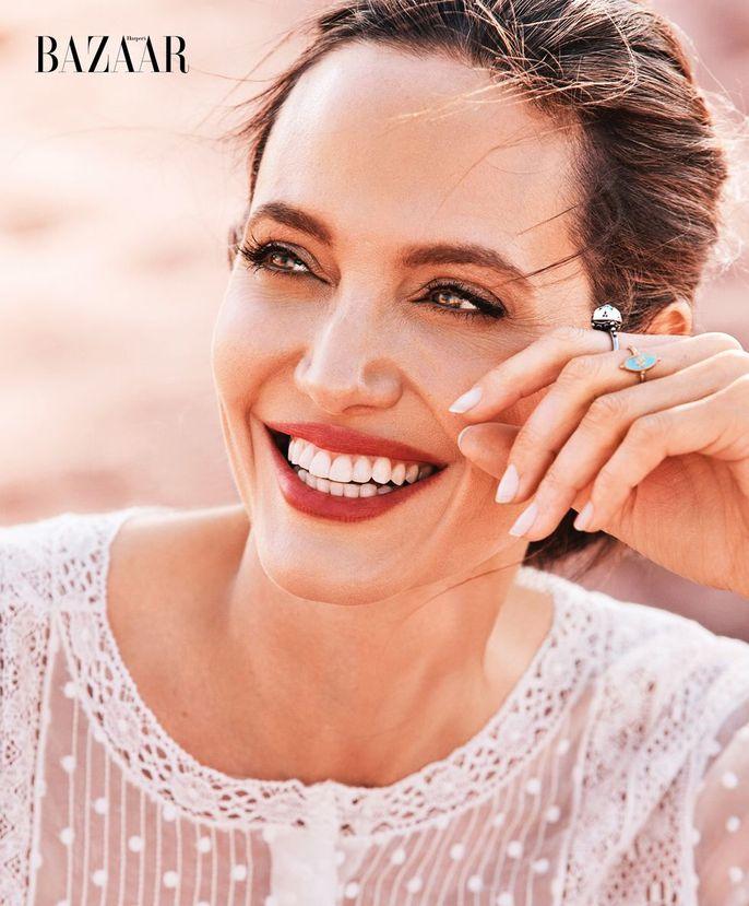 Angelina Jolie đẹp cùng báo đốm - Ảnh 5.