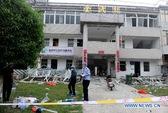 Trung Quốc: Ôm bom lao vào cuộc họp ủy ban