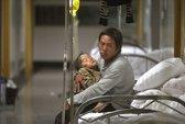 Động đất ở Trung Quốc: Dùng cuốc bới con từ đống đổ nát