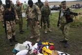 Vụ máy bay Malaysia rơi: Hỗn loạn cảnh hôi của