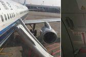 Một người Trung Quốc mở cửa thoát hiểm máy bay vì tưởng toilet