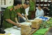Bị truy nã, trốn sang Lào buôn 58 kg heroin về nước