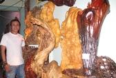 Chàng cắt tóc mê điêu khắc gỗ