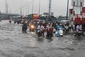 Triều cường và mưa lớn gây ngập diện rộng