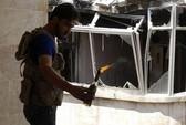 Quân nổi dậy Syria chĩa súng vào nhau
