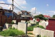 Di dời cuốn chiếu nghĩa trang trong khu dân cư
