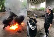 Khoe nhà giàu, cô gái mang xe ra chân cầu Phú Mỹ đốt