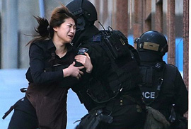 Sydney: Tay súng cảnh báo 4 quả bom, 5 con tin chạy thoát