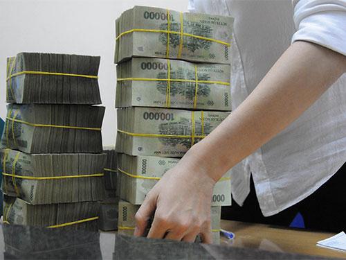 Một nguyên nhân quan trọng khiến việc kiểm soát thu nhập còn nhiều hạn chế là do nền kinh tế Việt Nam vẫn chủ yếu sử dụng tiền mặt Ảnh: HỒNG THÚY