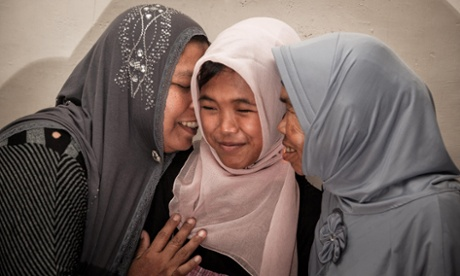Raudhatul Jannah is hugged by her mother Jamaliah, left, and grandmother after they were reunited in Meulaboh, Aceh, Indonesia,