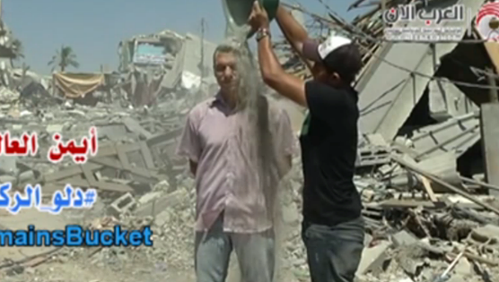 Photo: Rubble Bucket Challenge launched in Gaza after #IceBucketChallenge success. More here: http://fw.to/af7d2gZ