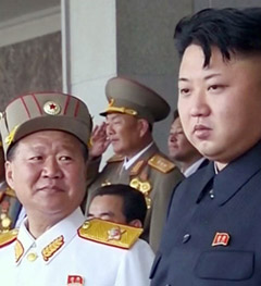 Choe Ryong-hae (left) smiles at North Korean leader Kim Jong-il during a military parade in Pyongyang in July last year.