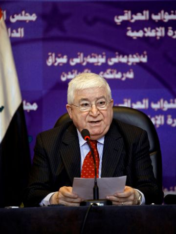 FILE - In this Tuesday, July 27, 2010, file photo, Acting Speaker Fouad Massoum speaks to the press after an Iraqi Parliament session in Baghdad, Iraq.