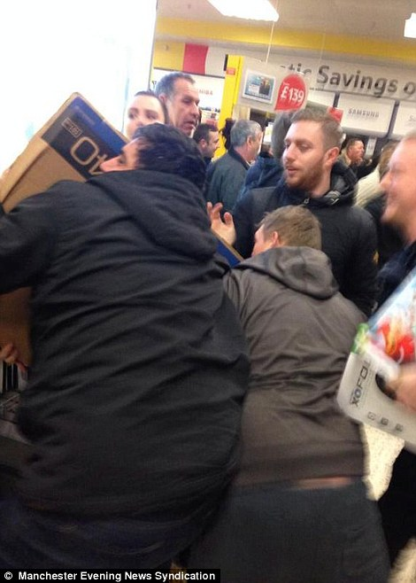 Shoppers could be seen scrambling among themselves desperately trying to pick up some of the cut-price goods