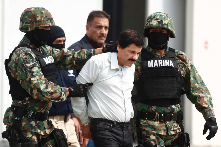 Joaquin Guzman, known as Shorty or El Chapo, is escorted by soldiers at the Navys airstrip in Mexico City.