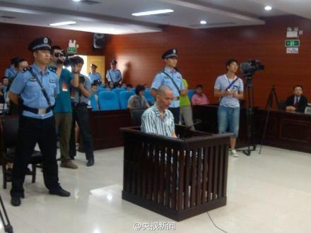 Nghi phạm He Shenguo tại tòa án hôm 19-6. Ảnh: Sina English