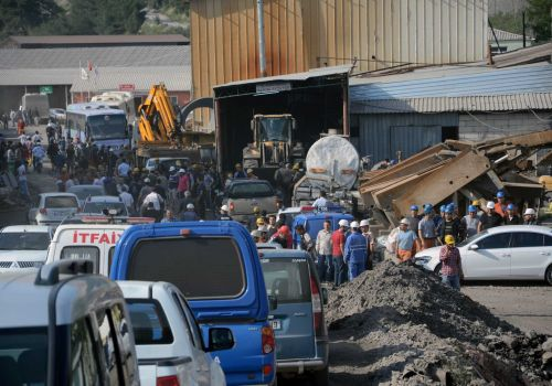 Rescue workers at the entrance of the mine after an explosion and fire at a coal mine in Soma, in western Turkey, Tuesday, May 13, 2014. An explosion and fire at a coal mine in western Turkey killed at least one miner Tuesday and left up to 300 workers trapped underground, a Turkish official said. Twenty people were rescued from the mine in the town of Soma in Manisa province but one later died in the hospital, Soma administrator Mehmet Bahattin Atci told reporters. The town is 250 kilometers (155 miles) south of Istanbul. TURKEY OUT Photo: IHA, AP / IHA