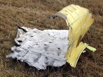 Mảnh vỡ MH17 do phóng viên tờ The New York Times chụp được. Ảnh: The New York Times
