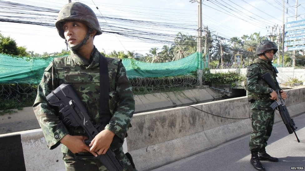 Thai soldiers take up a position on a main road in Bangkok following the imposition of martial law