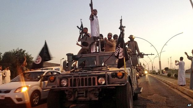 IS militants parade in Mosul. 23 June 2014