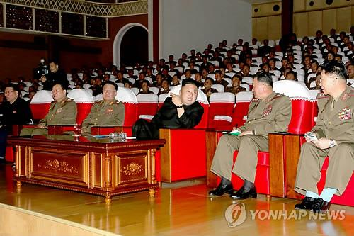 North Korean leader Kim Jong-un watches military performances during the first contest of the Korean Peoples Army. (Yonhap)