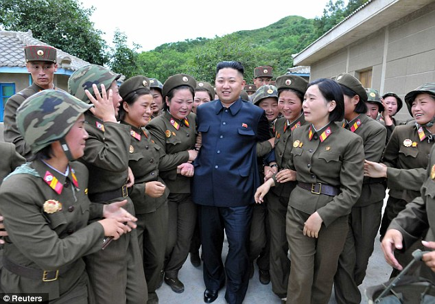 With the ladies: North Korean dictator Kim Jong Un with female members of the Korean Peoples Army Unit 4302 in an undated picture. Many of the artillery units along the coasts are manned with women