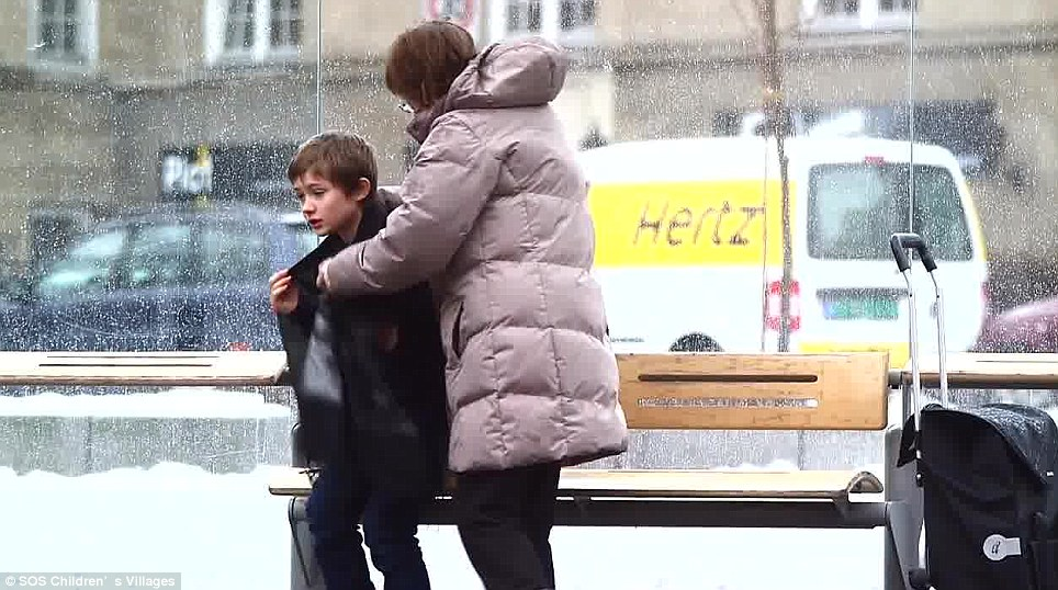 Another woman tries to help him track down his teacher, and then wraps him up in her scarf. She later gives him her coat as well
