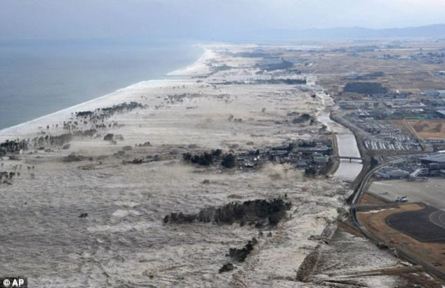 Devastating: Mrs Takamatsu, then 47, is one of thousands of people still missing three years after the sixth largest earthquake in recorded history devastated Japan. Above, towering waves strike the countrys coast