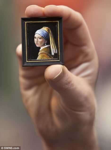 A miniature replica of The girl with the pearl earing painting on show at the Miniatura exhibition and trade show at the NEC in Birmingham