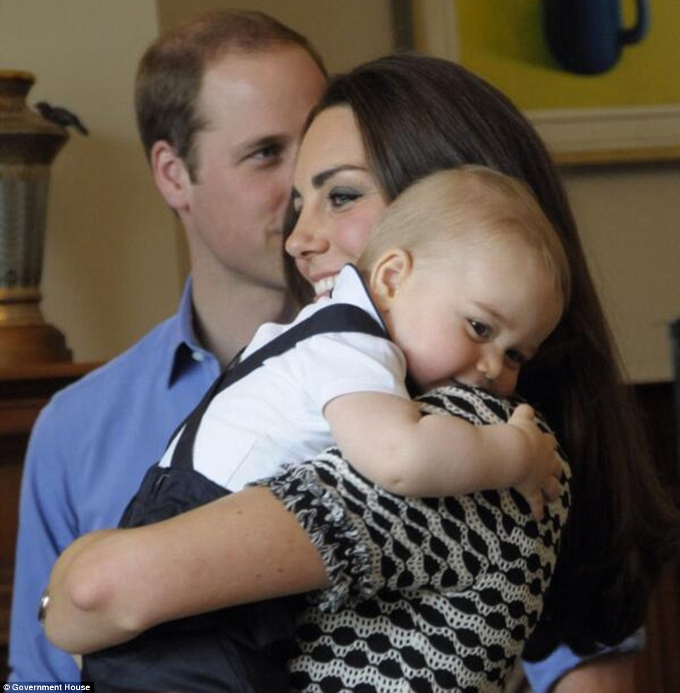 Prince George hugged tightly to his mothers arms as William, who had been swapping stories with the other parents, looked on