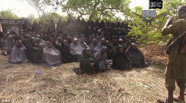 A still taken from a video by Nigeria's Boko Haram terrorist network shows the missing girls. A top Nigerian military official says the authorities know where the girls are, but cannot move in over fears for their safety