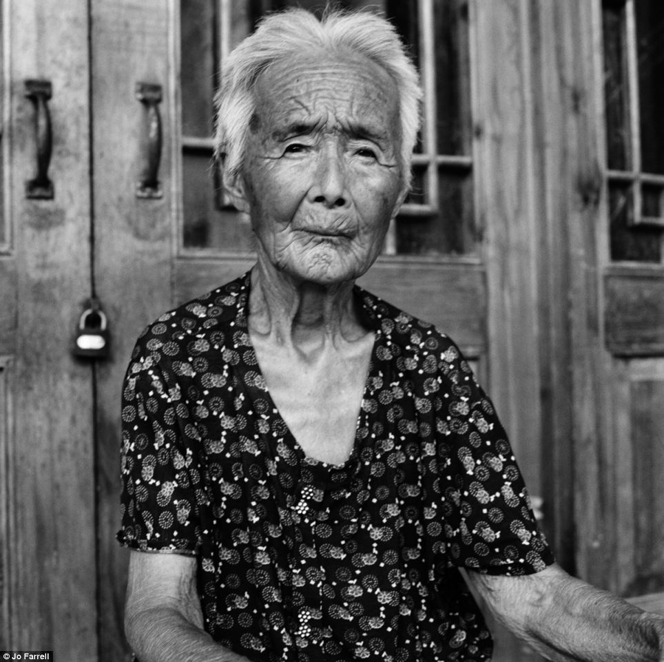 Portrait: Zhao Hua Hong is one of the women photographed by Hong Kong-based Jo Farrell who had their feet bound as a child in rural China