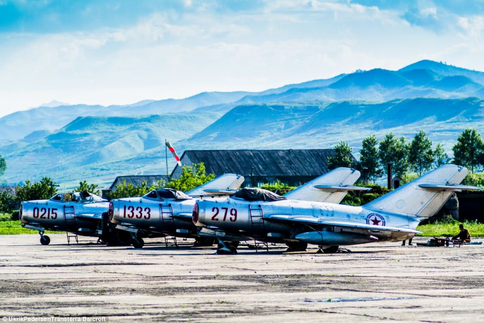 Danish photographer Pedersen said he didnt believe any of the stories the tour guides told him, and noticed that fake buildings had been set up to trick him (pictured, jets on a runway in Chilbosan)