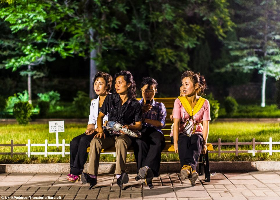 At first Pedersen was amazed to see people living normal lives - such as these women in a youth park in Pyongyang - but he quickly realised he was being deceived