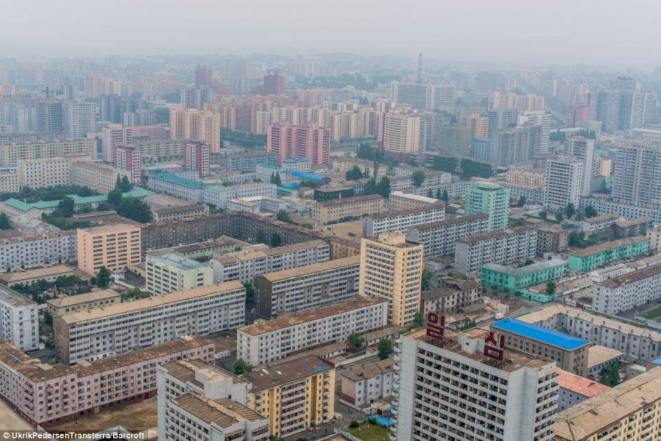 Mist hangs low over blocks of apartment buildings in this shot Pedersen took in the North Korean capital of Pyongyang while being given a guided tour of the country