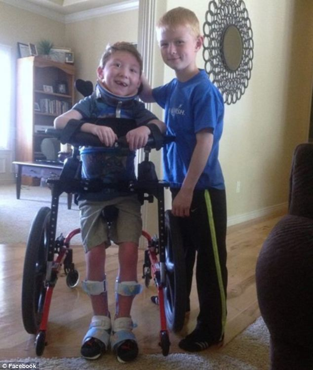 Best friends: Noah called his younger brother, who cannot walk or talk or eat on his own, perfect