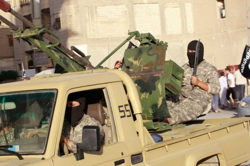 File: A knife wielding Islamic State militant sits at the helm of an anti-aircraft gun. Reuters