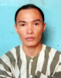 Đậu Quang Vỹ tại cơ quan công an.