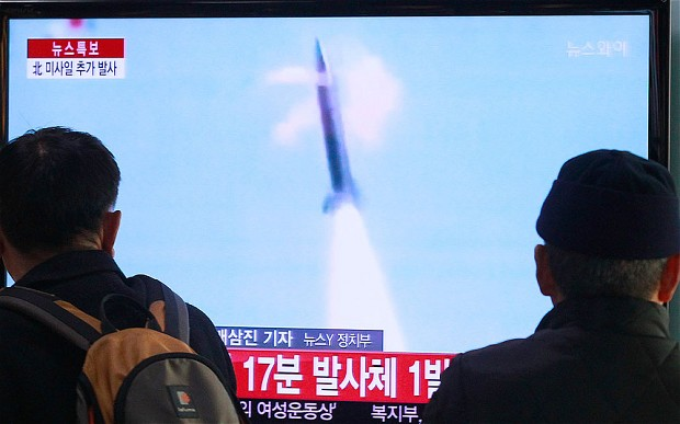 People watch TV reporting North Koreas missile test at Seoul Railway Station in Seoul