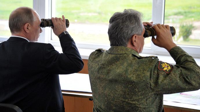 Russian President Vladimir Putin and Russian Defense Minister Sergei Shoigu (RIA Novosti/Aleksey Nikolskyi)