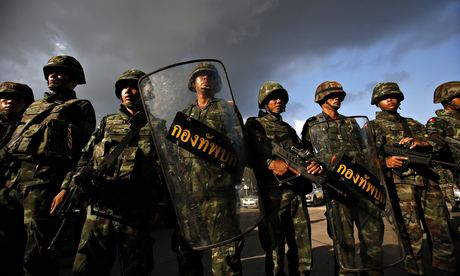 Thai soldiers stand guard during a coup at the Army Club in central Bangkok