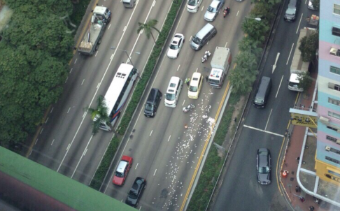 Cash is strewn over Gloucester Road in Wan Chai. Photo: SCMP