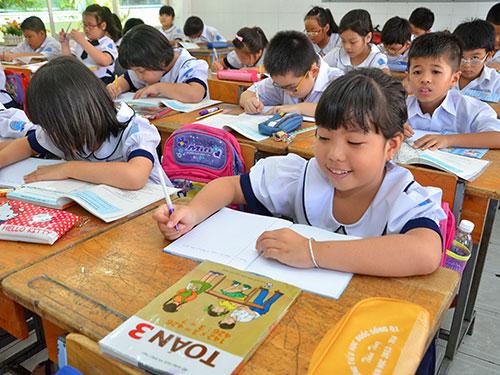 Học sinh Trường Tiểu học Đuốc Sống (TP HCM) hào hứng vào năm học mới Ảnh: Tấn Thạnh