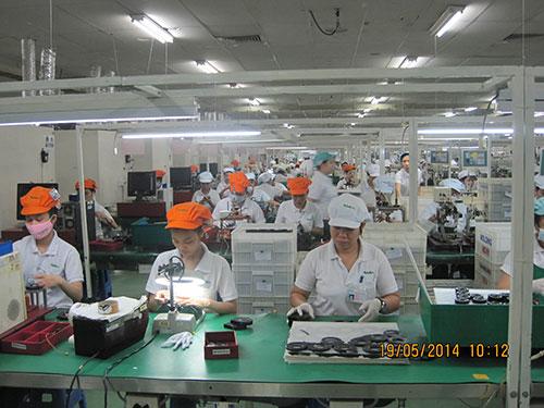 Công ty Nidec Việt Nam 100% vốn Nhật Bản, chuyên sản xuất motor quạt trong Khu Công nghệ cao TP HCM Ảnh: HỒNG ĐÀO