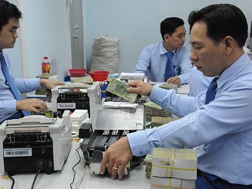 Nhiều ngân hàng thương mại đang đẩy mạnh cho vay khách hàng có nhu cầu về nhà ở Ảnh: Hồng Thúy