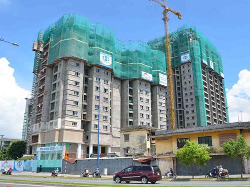 Dự án căn hộ 381 Bến Chương Dương, quận 1, TP HCM do Tập đoàn Công nghiệp Cao su Việt Nam làm chủ đầu tư bị chậm tiến độ 4 năm Ảnh: Tấn Thạnh