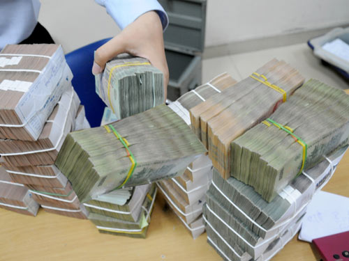 Vì sao các ngân hàng giảm mạnh lãi suất huy động? - Ảnh 1.