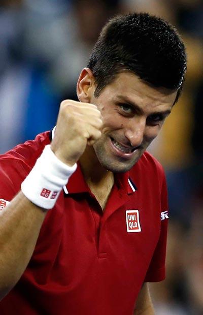 Djokovic có chiến thắng vất vả tối 9-10, vào tứ kết gặp Ferrer  Ảnh: REUTERS