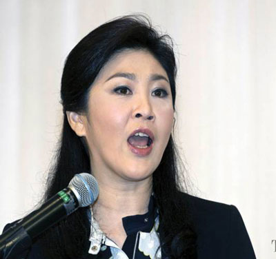 Bà Yingluck tuyên bố sẽ không bỏ chạy như anh trai. Ảnh: THE NATION